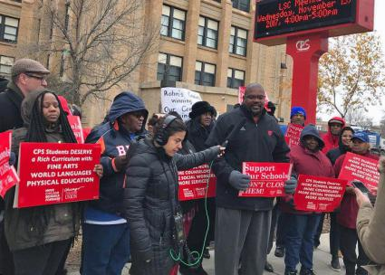 Parents, community and staff protest the planned closure of Harper High School on the South Side (Chicago Teachers Union | Facebook)