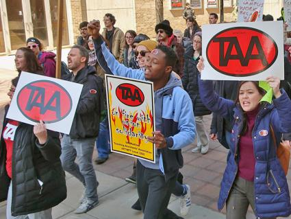 Graduate workers rally against mandatory fees at the University of Wisconsin (TAA - Graduate Worker Union of UW-Madison | Facebook)