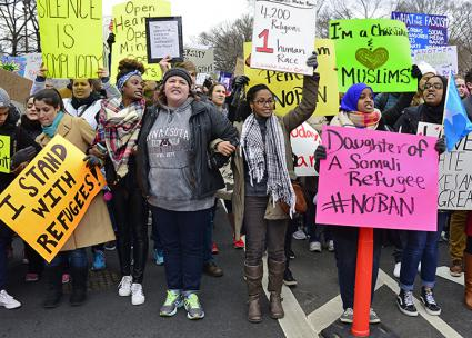 A crowd takes the streets in Washington, D.C., to protest Trump's Muslim ban (Stephen Melkisethian)