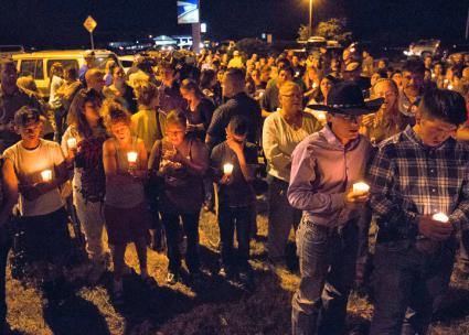 Residents of Sutherland Springs, Texas, hold a candlelight vigil