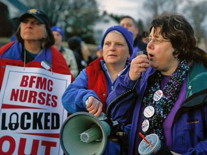 Donna Stern (right) speaks to nurses after the lockout at Baystate Franklin Medical Center