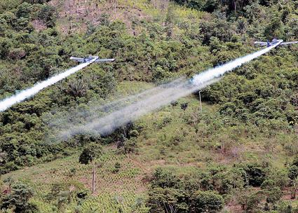 Military airplanes spray toxic chemicals on coca crops in the Colombian countryside