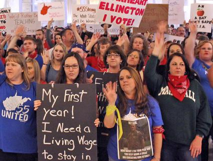 Striking teachers rally for their demands in the West Virginia state Capitol building
