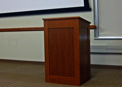 Empty podium in a college lecture hall (Karin Dalziel)