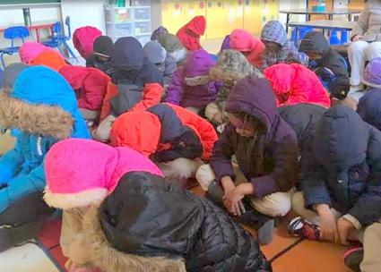 Children struggle to stay warm in an unheated classroom in Baltimore (Samierra Jones)