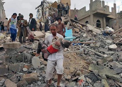 Civilians rescue a child from the rubble after a coalition air strike in Sana'a