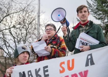 Professor Dana Cloud (center) speaks to a student protest at Syracuse University (Colin Davy | The Daily Orange)