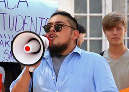 Immigrant rights activist Eric Nava-Perez speaks at a protest in Texas