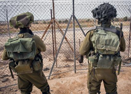 IDF soldiers patrol the borders of Gaza near the Kerem Shalom crossing