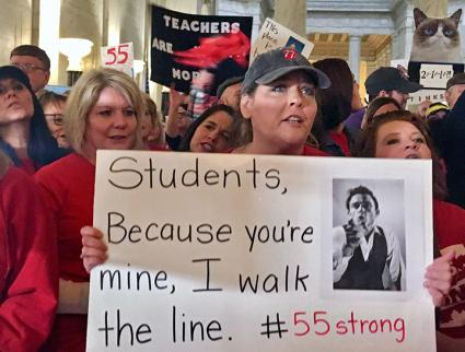 Striking teachers march through the West Virginia State Capitol building