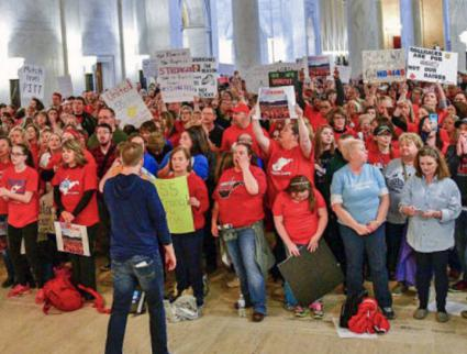 Striking teachers mass inside the West Virginia State Capitol building