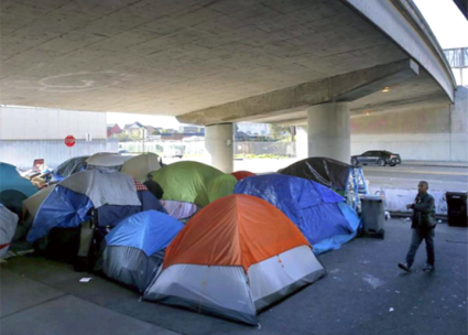 A homeless encampment underneath an interstate overpass in Oakland