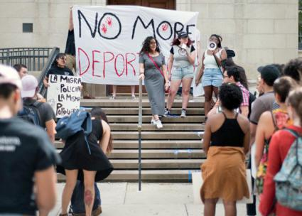 Students protest an ICE official invited to speak at Northwestern University (Colin Boyle | The Daily Northwestern)