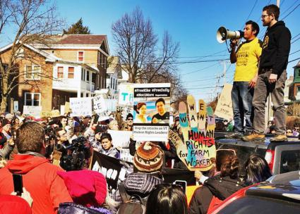 Immigrant rights activist Victor Diaz speaks to a protest against the arrests in Burlington (Migrant Justice)