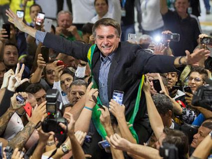 Far-right presidential candidate Jair Bolsonaro greets supporters in Curitiba, Brazil