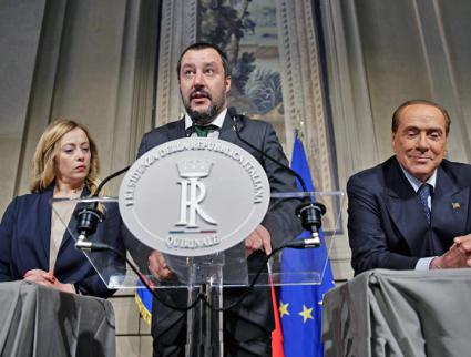 Northern League leader Matteo Salvini speaks, flanked by right-wing politician Giorgia Meloni and former Prime Minister Silvio Berlusconi