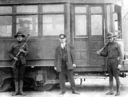 National Guard troops patrol a streetcar station during the Kansas City General Strike (Wikimedia Commons)