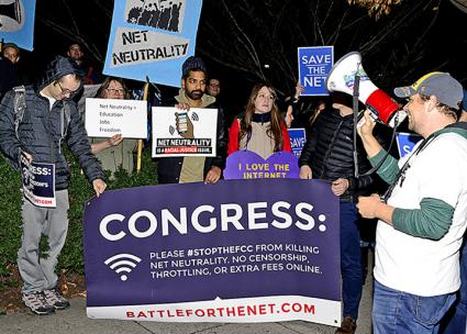 Defenders of net neutrality protest FCC Chair Ajit Pai and telecom lobbyists in Washington, D.C. (Stephen Melkisethian | flickr)