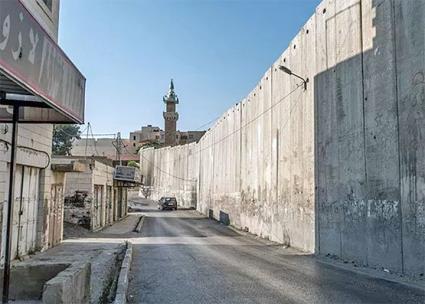 Israel's apartheid wall runs through the Palestinian town of Abu Dis (Camden Abu Dis Friendship Association)