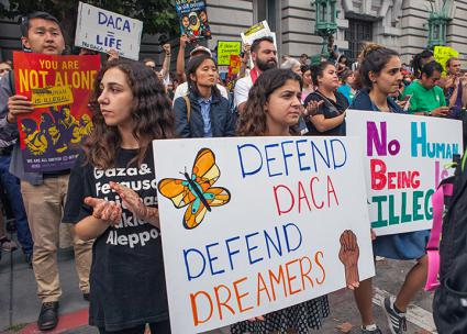 Protesters take a stand to defend DACA from Trump's attacks (Pax Ahimsa Gethen | Wikimedia Commons)