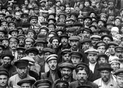 Factory workers in Petrograd pose for a photograph after an organizing meeting (Viktor Bulla)