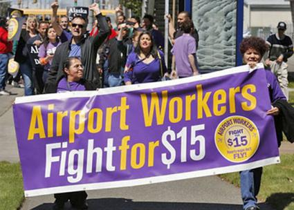 Workers at Seattle-Tacoma International Airport march for a living wage