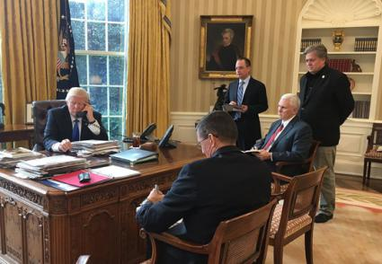 Donald Trump phones Vladimir Putin from the Oval Office in January (White House)