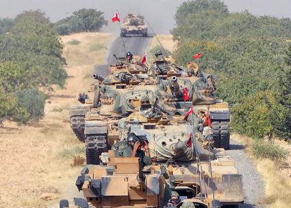 Turkish tanks roll into Syria as part of an assault on the Kurdish region of Afrin