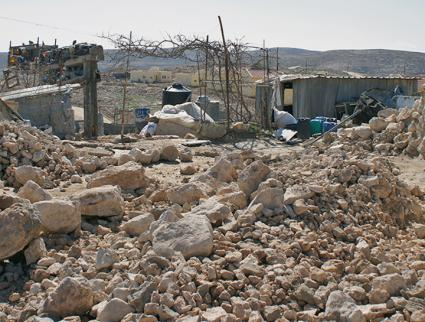 The rubble of a home demolished by Israeli troops in the village of Umm al-Khair (Friends123 | Wikimedia Commons)