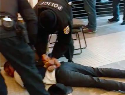 Loyola University police officers pin down a socialist student activist (Loyola Socialists - ISO | Facebook)