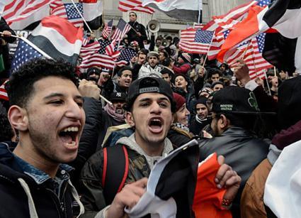 Yemeni bodega owners and workers rally at Brooklyn's Borough Hall against Trump's Muslim ban