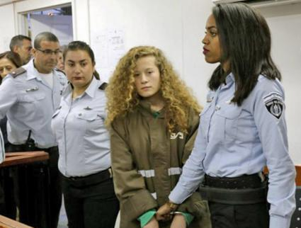 Palestinian political prisoner Ahed Tamimi is brought into an Israeli military courtroom