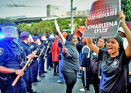 Activists demonstrate against the police murder of Charleena Lyles in Seattle