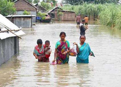 Residents of rural Bangladesh attempt to escape deadly floodwaters