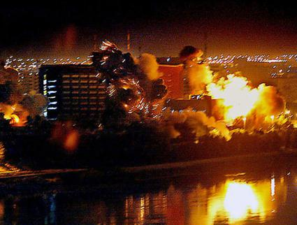 "Bombs fall on government buildings in Baghdad during the ""shock and awe"" bombardment at the beginning of the war"