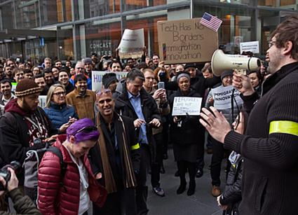 Comcast workers in Philadelphia stage a walkout in opposition to President Trump's Muslim ban
