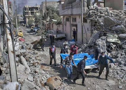 Residents pull victims from the rubble following a coalition air strike in Mosul