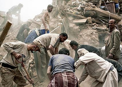 An emergency response team searches for victims in the rubble after a Saudi air strike in Sana'a