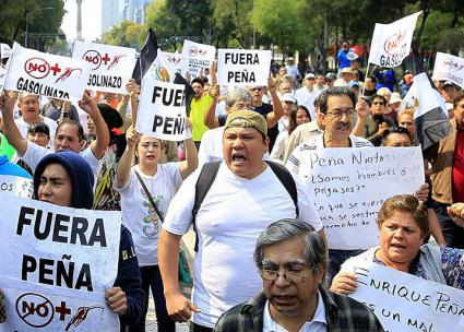 Protesters flood the streets of Mexico City to oppose gas price hikes and a corrupt president