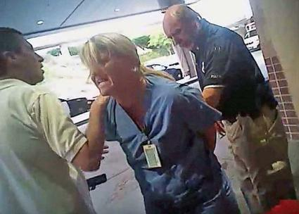 Nurse Alex Wubbels (center) is put under arrest in Salt Lake City