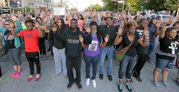 Protesters pour into the streets of St. Louis to demand justice for Anthony Lamar Smith