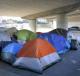 A homeless encampment underneath an interstate overpass in Oakland