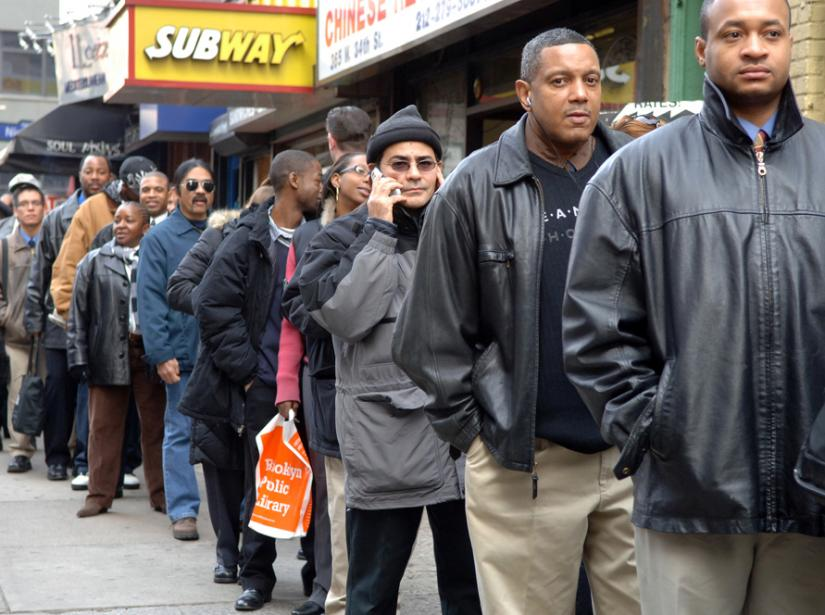 Applicants line up at a job fair at the New Yorker Hotel in January 2007