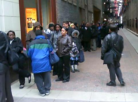 Hundreds of people stand in line to apply for jobs at the new Hotel Wit in Chicago