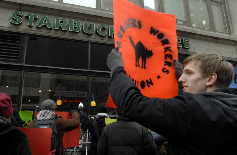 Starbucks workers and their supporters protest outside a New York City store