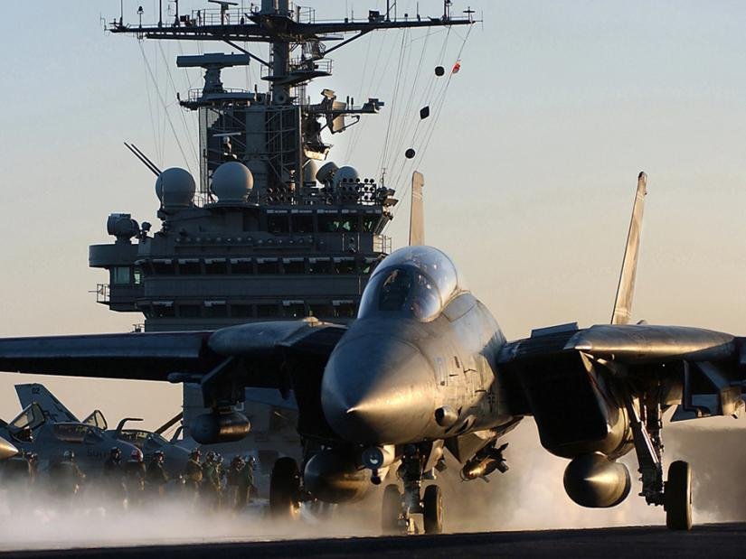 An F-14 fighter jet takes off from a Navy air craft carrier in the Persian Gulf