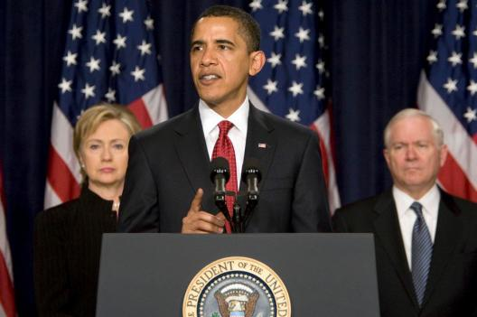 President Barack Obama, flanked by Secretary of State Hillary Clinton and Defense Secretary Robert Gates