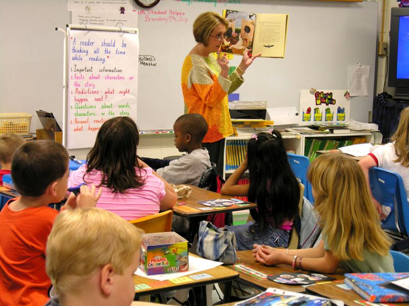 An elementary school teacher leads a guided reading lesson