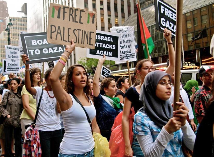 Protesters march in New York City for an end to the siege of Gaza following Israel's massacre on the Mavi Marmara