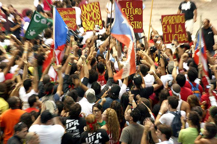 Participants in the University of Puerto Rico student strike celebrate their victory